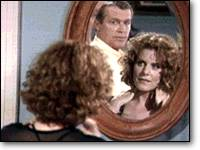 Blake and Ross in mirror.
